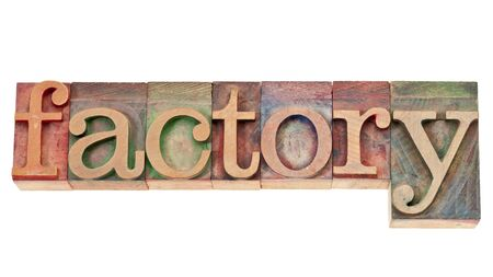 factory - isolated word in vintage letterpress wood type stained by color inks Stock Photo - 14968429