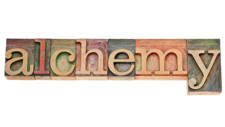 alchemy - isolated word in vintage letterpress wood type stained by color inks Stock Photo - 15031358