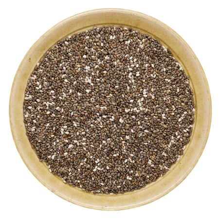 hispanica: chia seeds (Salvia Hispanica) in a round ceramic bowl isolated on white