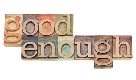 good enough - attitude or software design principle - isolated words in vintage letterpress wood type stained by color inks Imagens
