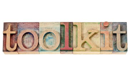 toolkit: toolkit -  a set of tools or software -isolated word in vintage letterpress wood type stained by color inks isolated word in vintage letterpress wood type stained by color inks Stock Photo