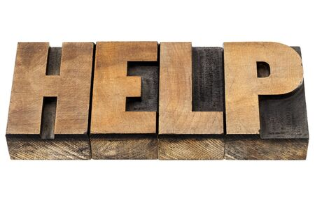 help - isolated word in vintage leterpress wood type Stock Photo - 15488387