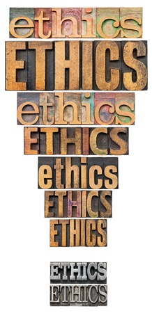 ethics word abstract in a form of exclamation point - a collage of isolated text in vintage letterpress wood and metal type Stock Photo - 15148362