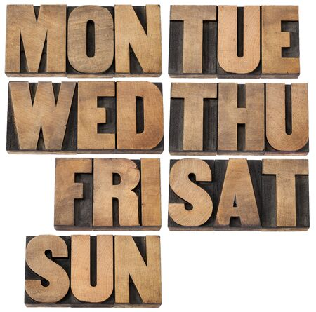 seven days of week (first 3 letter symbols) in isolated vintagewood letterpress printing blocks Stock Photo - 15279903