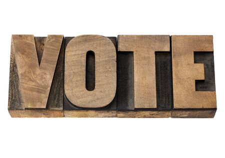 printing block block: vote - election concept - isolated word in vintage letterpress wood type