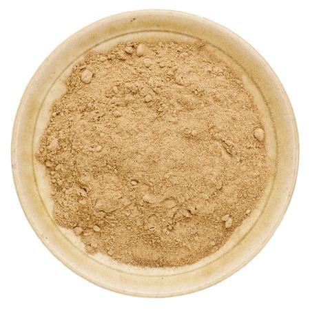 raw organic dried camu camu fruit powder (Myciara Dubia) in a small ceramic bowl - rainforest superfruit from Peru rich in vitamin C Stock Photo - 15279909