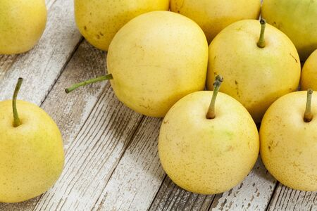 asian pears from home garden on grunge wood background Stock Photo - 15523393
