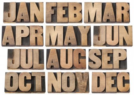 calendario diciembre: 12 meses, de enero a diciembre - un collage de tres s�mbolos de letras aisladas en bloques de tipograf�a tipo de madera de �poca