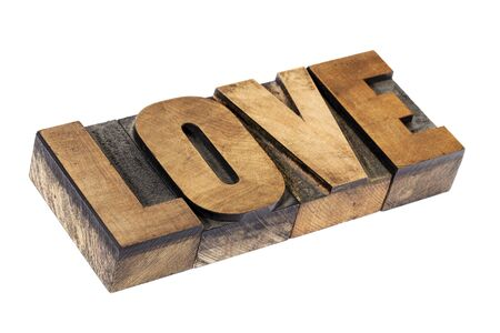 love word - isolated text in vintage letterpress wood type printing blocks Stock Photo - 15476524