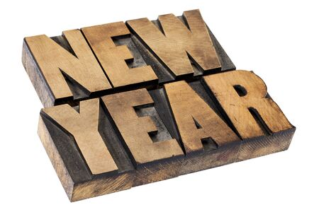 New Year  - isolated text in vintage letterpress  wood printing blocks Stock Photo - 15476529