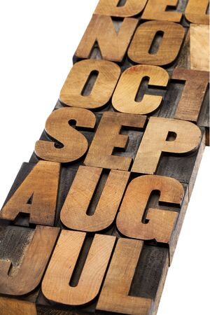calendar abstract - 3 letter month symbol - isolated text in vintage letterpress wood type printing blocks photo