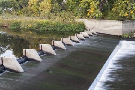 poudre river: small dam diverting water for farmland irrigation - Cache la Poudre River above Greeley in northern Colorado