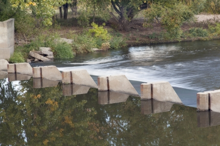 small dam diverting water for farmland irrigation - Cache la Poudre River above Greeley in northern Colorado Stock Photo - 15654935