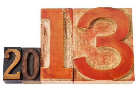 year 2013  - isolated text in vintage letterpress wood type, mixed fonts with oversized number thirteen Stock Photo - 15654939