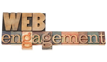 web engagement: web engagement - internet presence concept - isolated text in vintage letterpress wood type Stock Photo