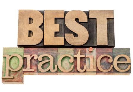 best practice - isolated words in vintage letterpress wood type Reklamní fotografie - 15776585
