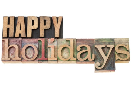 happy holidays - isolated text in vintage letterpress wood type Stock Photo - 15814405
