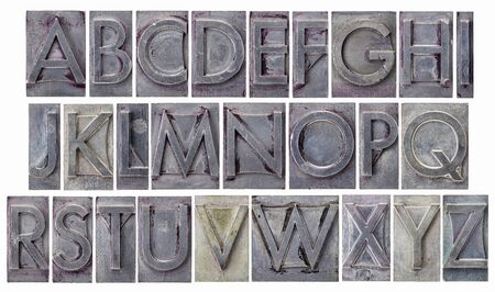 English alphabet - a collage of 26 isolated letters in grunge letterpress metal type, scratched and stained by ink photo