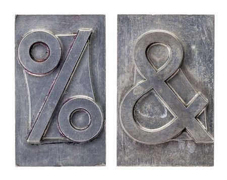 percent and ampersand -isolated symbols in vintage grunge metal letterpress printing blocks Stock Photo - 16126202