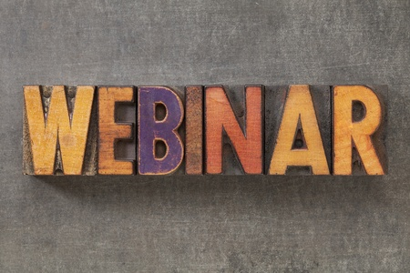 webinar - word in vintage letterpress wood type blocks against grunge metal background photo