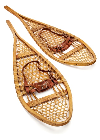 snowshoes: vintage wooden Huron snowshoes with leather binding on white