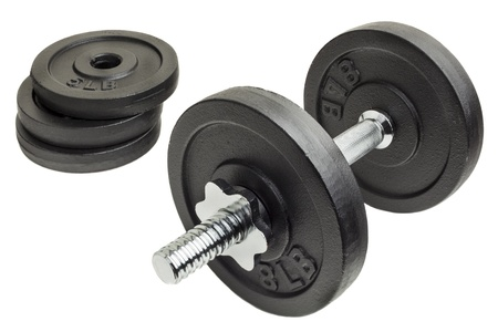 cast iron dumbbell and weight plates isolated on white background Stock Photo - 16295258