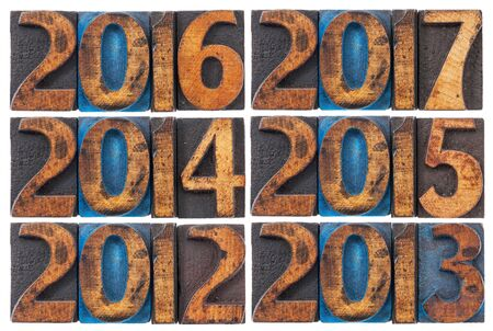 incoming: incoming years from 2012 to 2017 - isolated text in vintage letterpress wood type printing blocks stained by ink Stock Photo