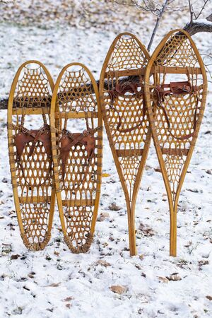 huron: Bear Paw and Huron vintage wooden snowshoes with leather binding