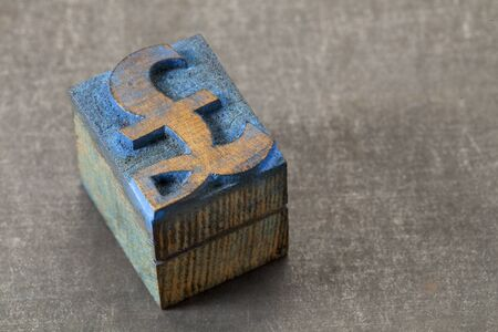pound currency symbol - vintage letterpress wood type block stained by blue ink on grunge metal background Stock Photo - 16295325