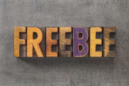 freebee word in vintage letterpress wood type blocks on grunge metal background Stock Photo - 16295326