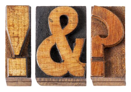 exclamation point: exclamation point , question mark and ampersand - isolated vintage letterpress wood type blocks