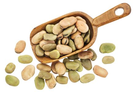 fave bean: fava or broad beans on rustic wooden scoop isolated on white