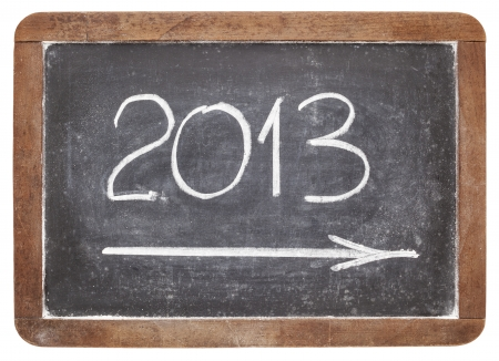 incoming 2013 year - white chalk on vintage slate blackboard Stock Photo - 16429869