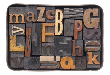 vintage letterpress wood type blocks with ink patina - all 26 letters of alphabet in an old metal box Stock Photo - 16529553