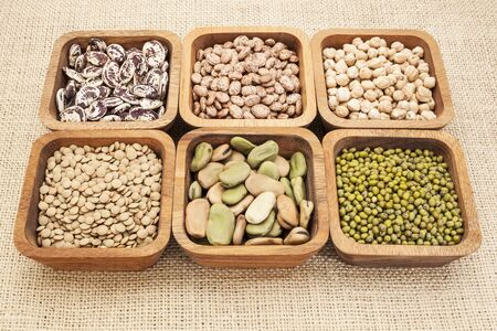 a collection of bean and lentil in wooden square bowls Stock Photo - 16604442