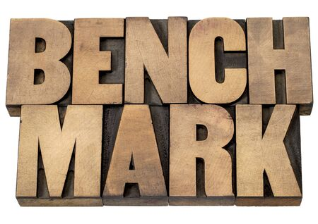 benchmark: benchmark - isolated word in vintage letterpress wood type printing blocks