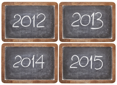 current and incoming years, 2012, 2013, 2014, 2015 on vintage slate  blackboards, isolated on white Stock Photo - 16645607