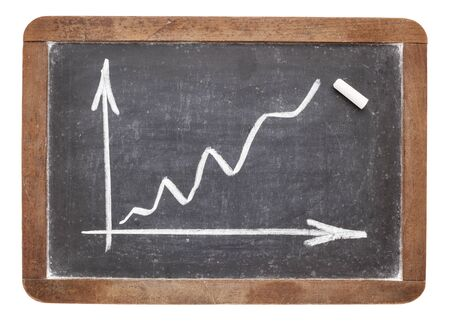 growth graph - white chalk drawing on vintage slate blackboard Stock Photo - 16645606