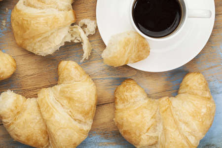 croissants and cup of coffee on grunge painted wood Stock Photo - 16645601