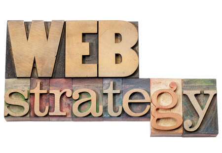 web strategy - isolated text in vintage letterpress wood type blocks Stock Photo - 16645600