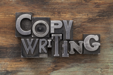 copywriting: copywriting - text in vintage letterpress metal type blocks on a grunge painted wood Stock Photo