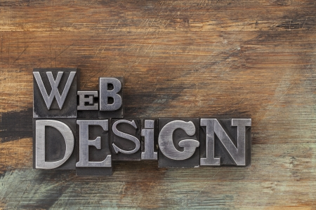 website words: web design - text in vintage letterpress metal type blocks on a grunge painted wood