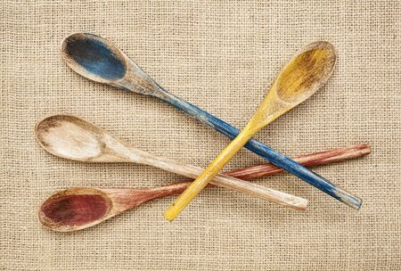 rustic wooden painted spoons on burlap canvas Stock Photo - 16770331