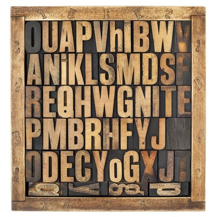 random letters of alphabet - vintage letterpress wood type blocks in rustic box isolated on white photo