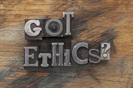 dilemma: Got ethics question in vintage letterpress metal type on a grunge painted wood background