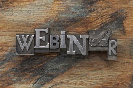 webinar word in vintage letterpress metal type on a grunge painted wood background Stock Photo - 16770333