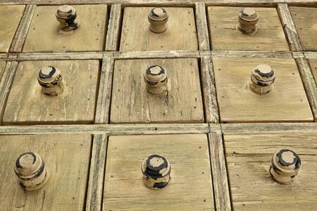 primitive wooden apothecary or catalog drawer cabinet, low view angle Stock Photo - 16770344