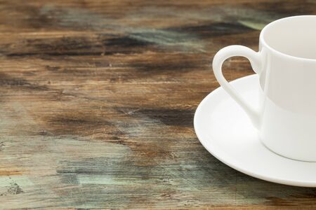 white china espresso coffee cup on wooden grunge table Stock Photo - 16770339