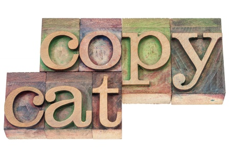 copycat: copycat  - isolated text in vintage letterpress wood type blocks stained by color inks Stock Photo
