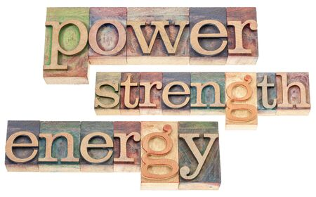 power, strength, energy words - isolated text in vintage letterpress wood type blocks stained by color inks Stock Photo - 16849075